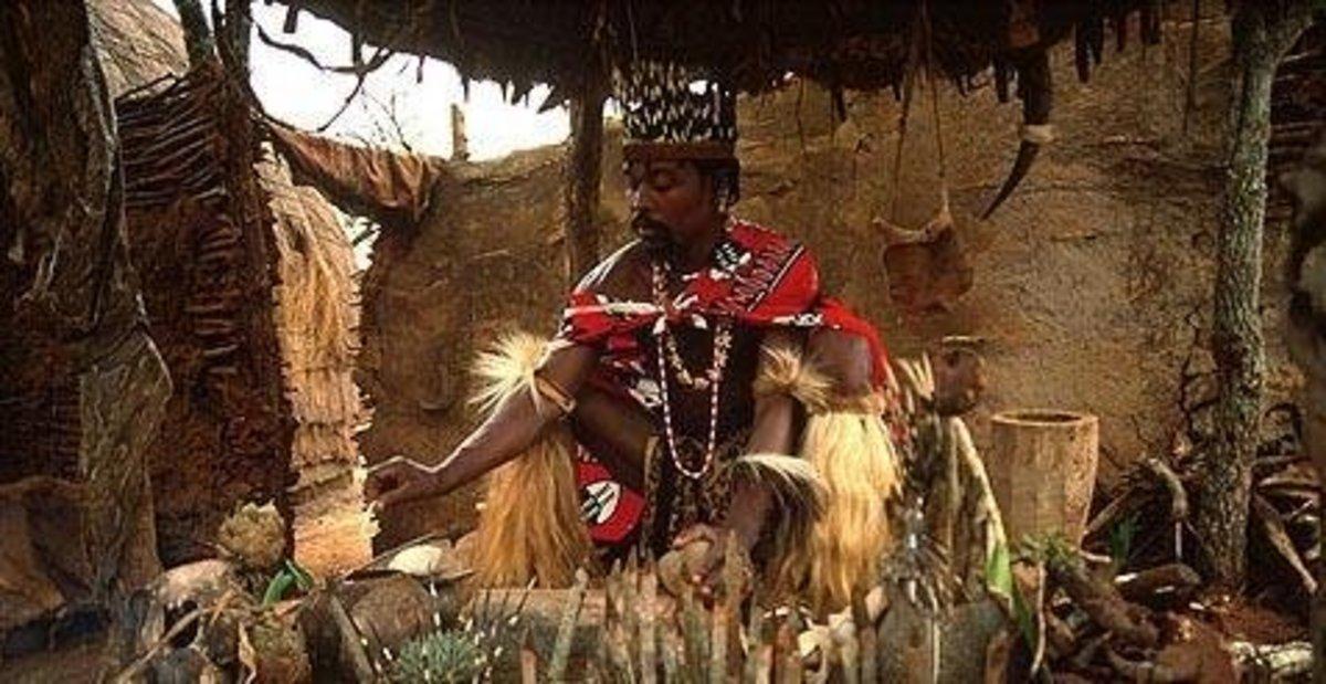 Typical African herbalist preparing to conjure spirits