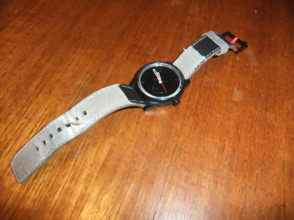 My watch, the strap a little worse for wear by now but still holding together