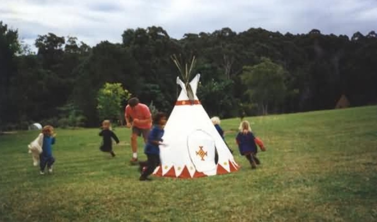 Tipi-play in the backyard.