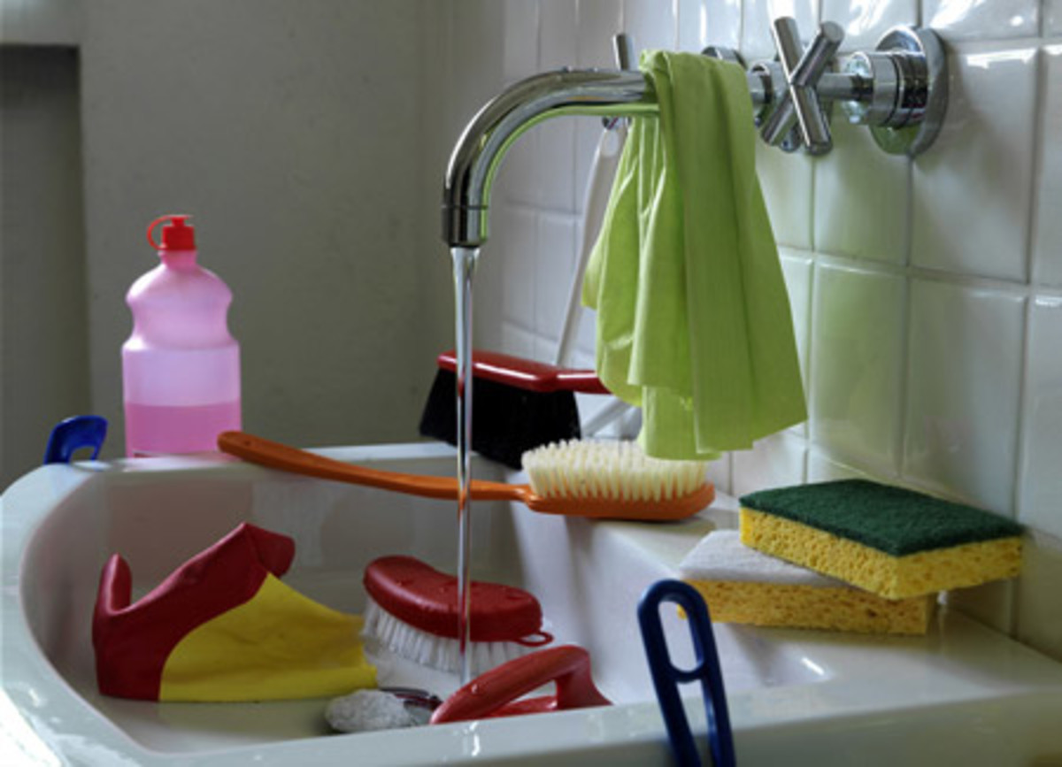 A running tap and the detritus of cleaning aids