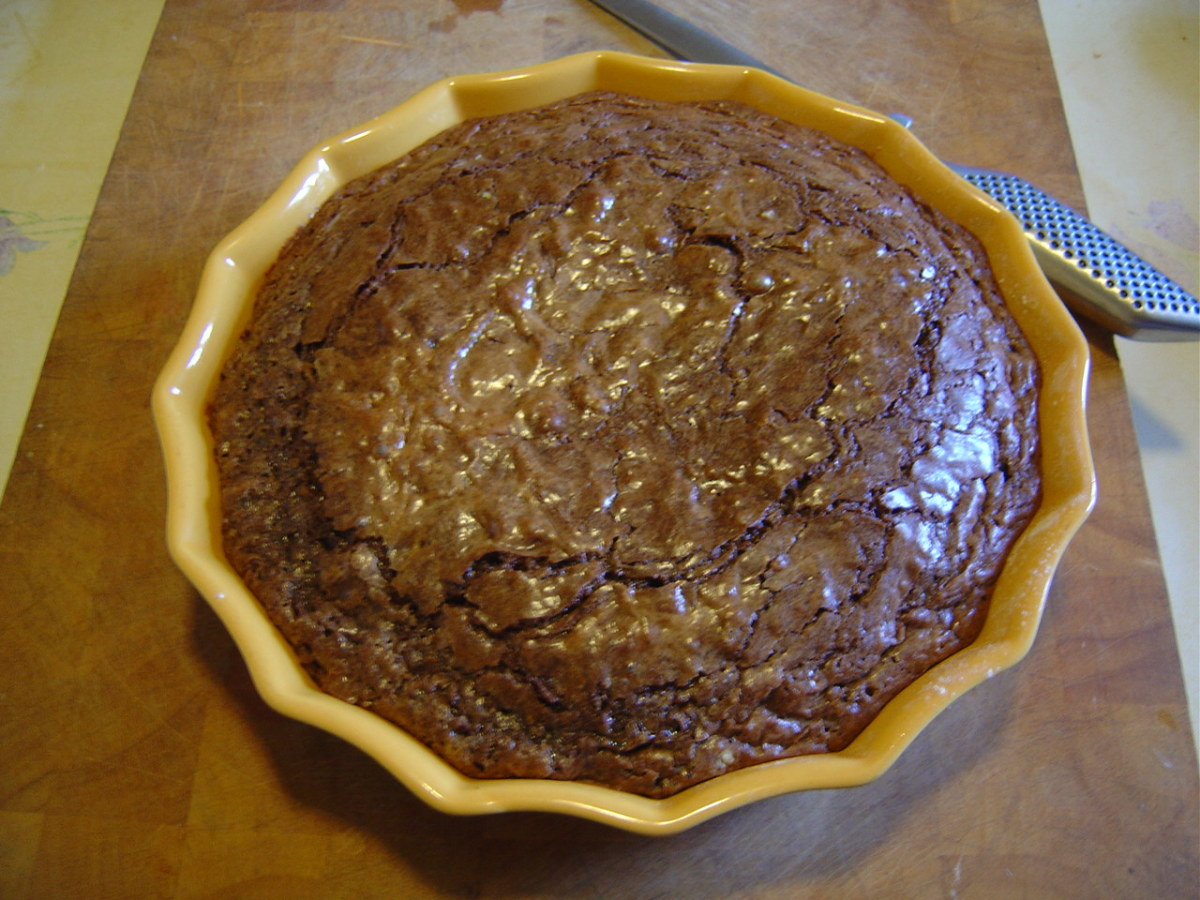 The chocolate cake is cooked when it begins to crack