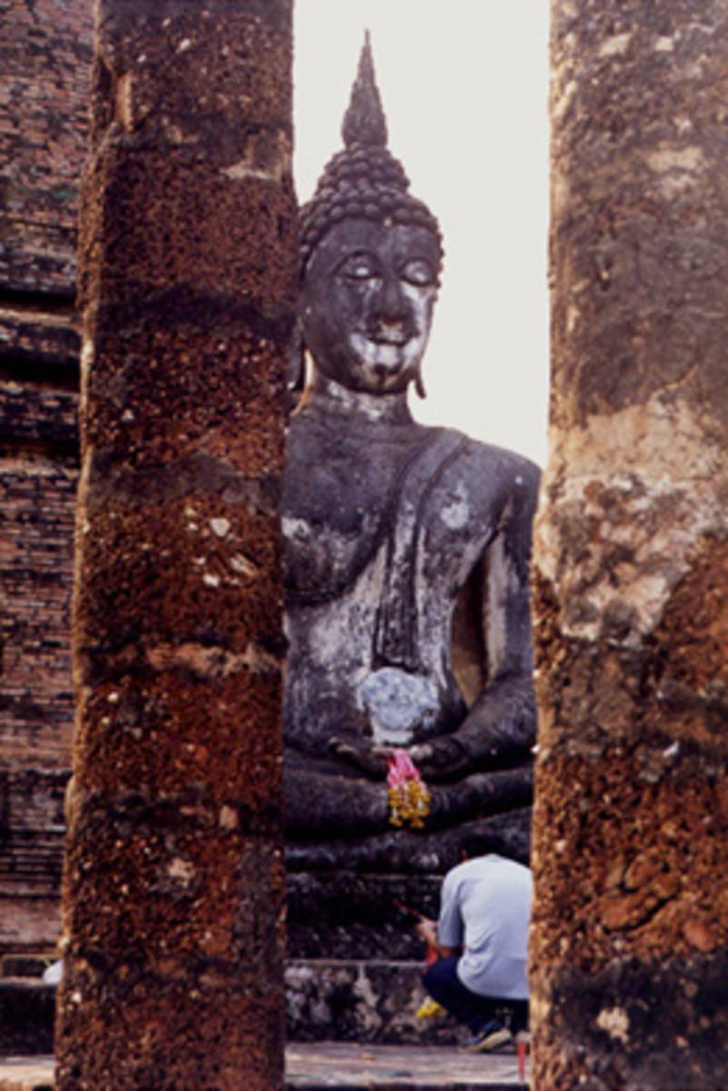 Thai Pays Respect to Buddha at Sukhothai Historical Park, Thailand