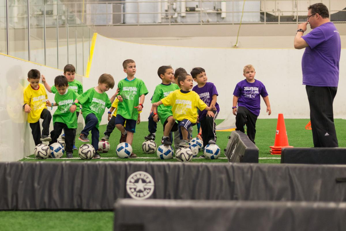 Children await coach's instruction