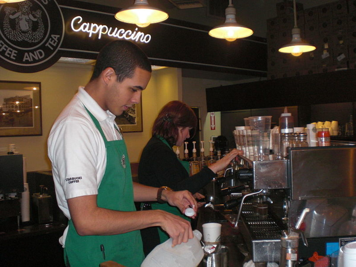 Baristas work inside the world's first Starbucks. source Wikipedia - history of coffee mugs