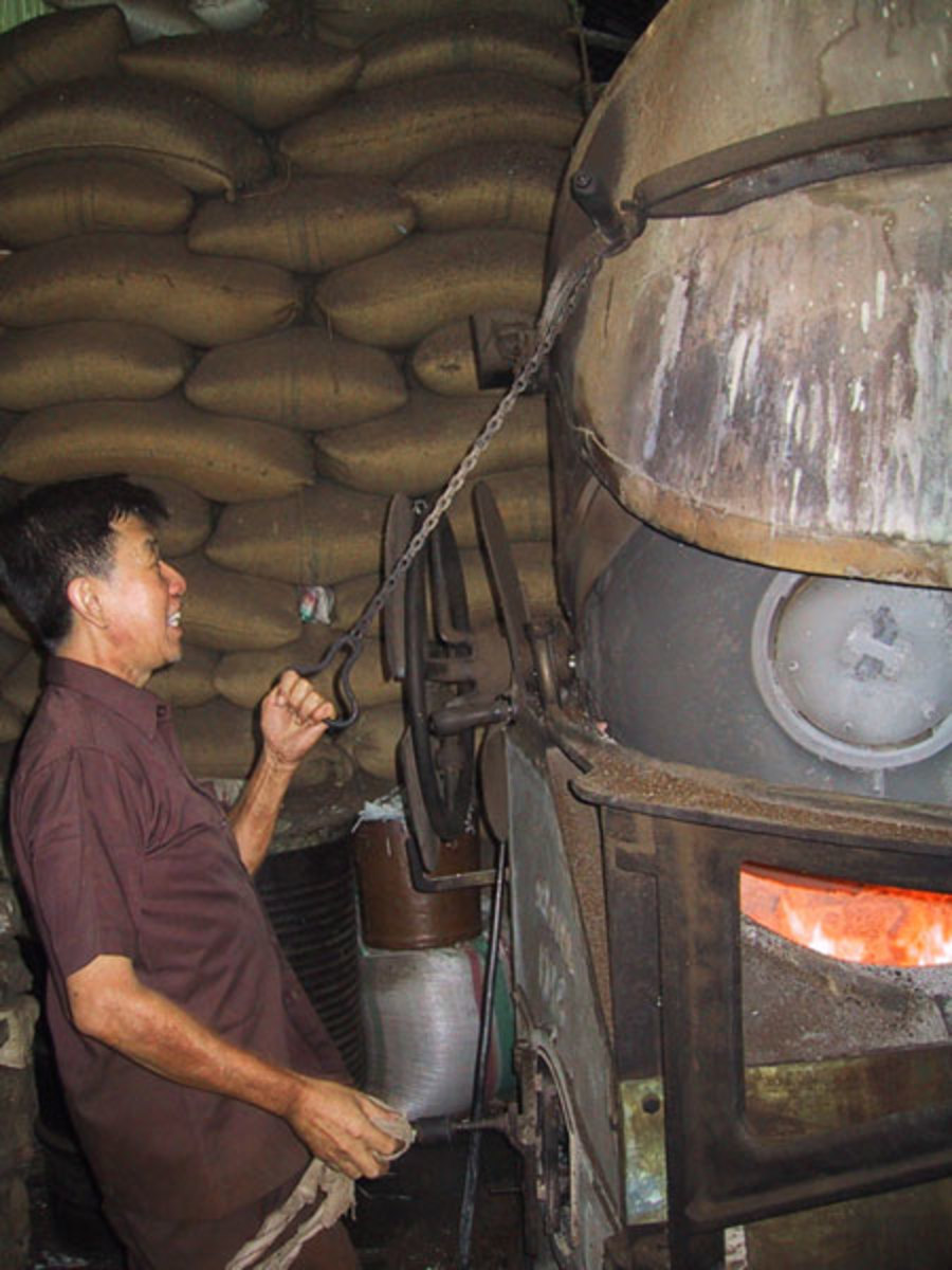 Coffee being roasted at Toko Aroma, Bandung, Indonesia, source Wikipedia - history of coffee mugs
