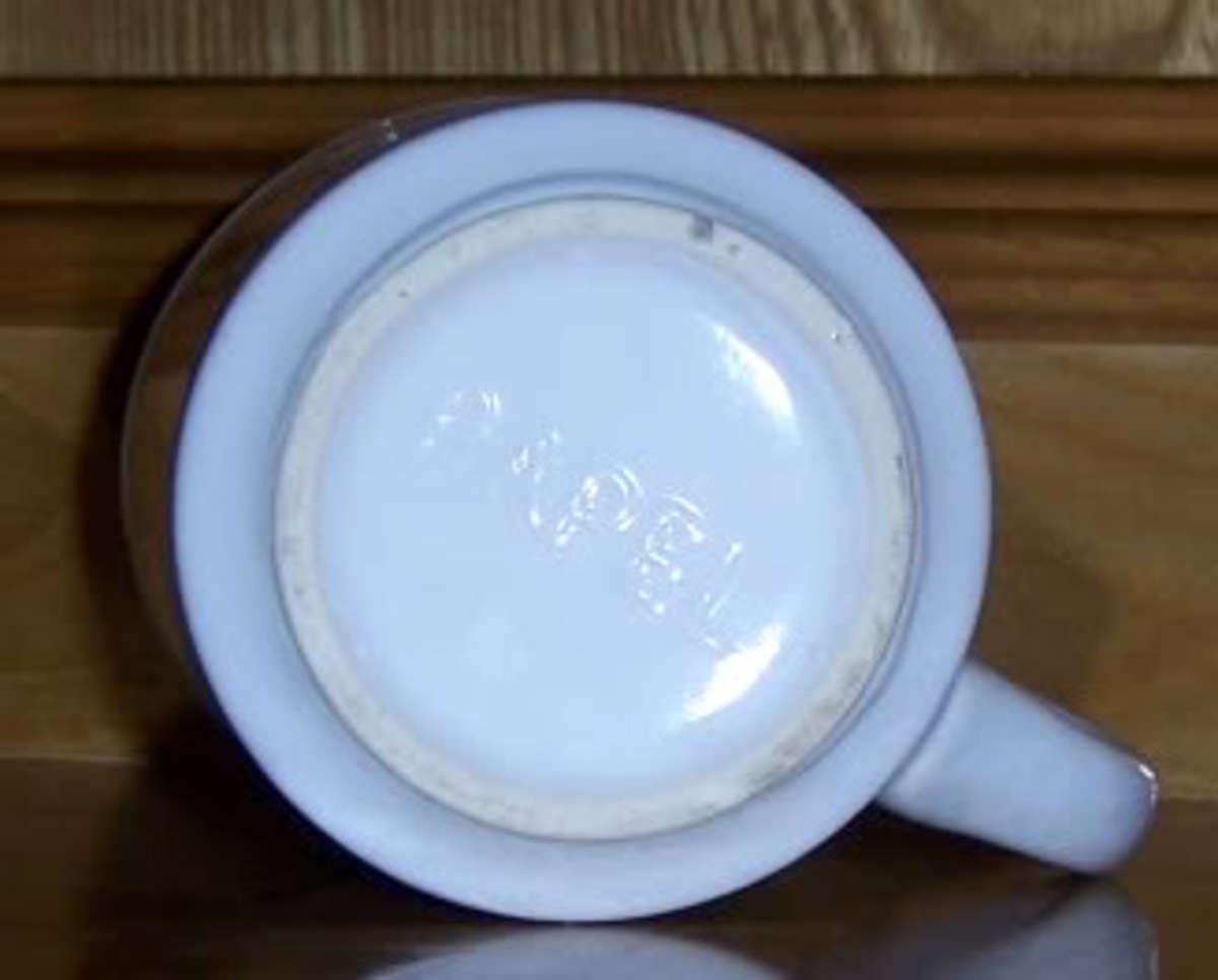 Bottom of coffee mug, photo By tj-lazer, source Photobucket - history of coffee mugs