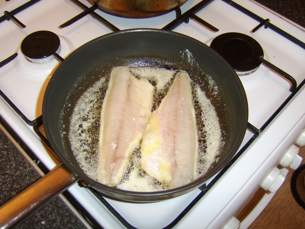 The sea bass fillets are shallow fried in butter
