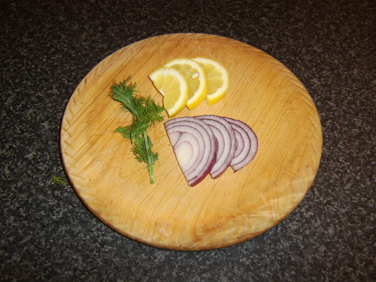 Lemon, red onion and fresh dill are used to stuff the sea bass