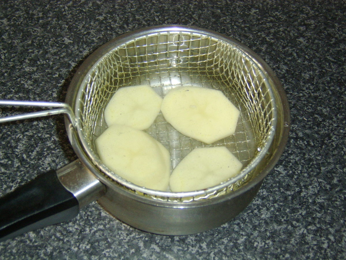 The potato slices are parboiled before being deep fried
