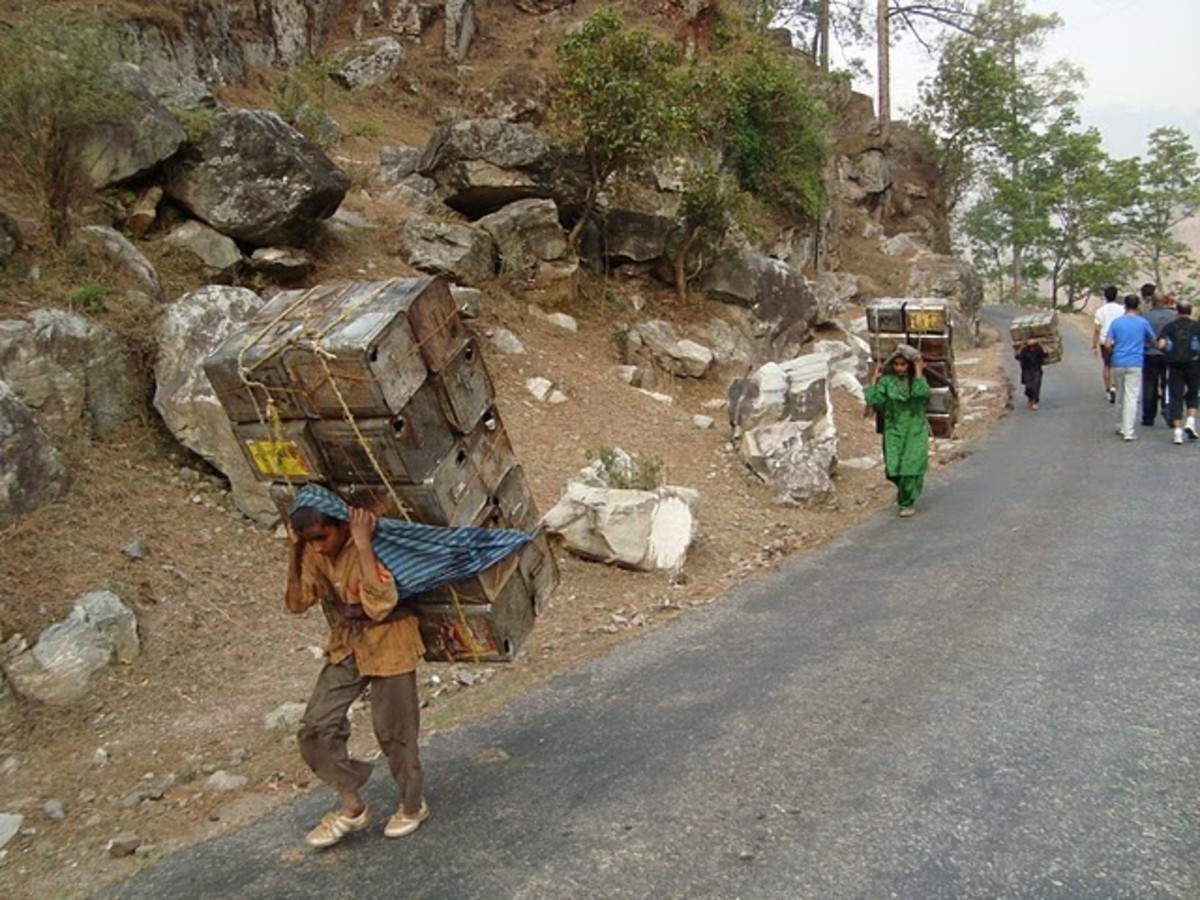 Mori villagers carrying empty oil tins.