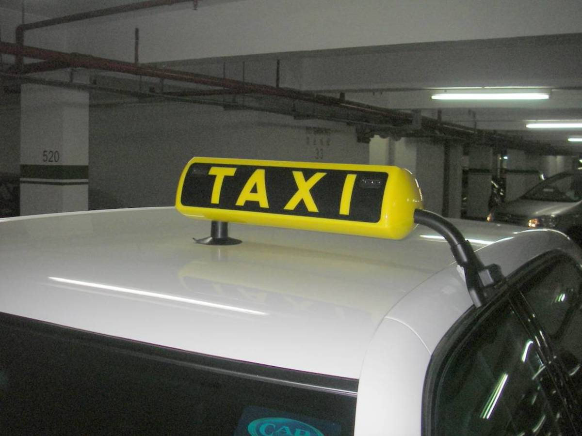taxi roof sign on a saloon type car