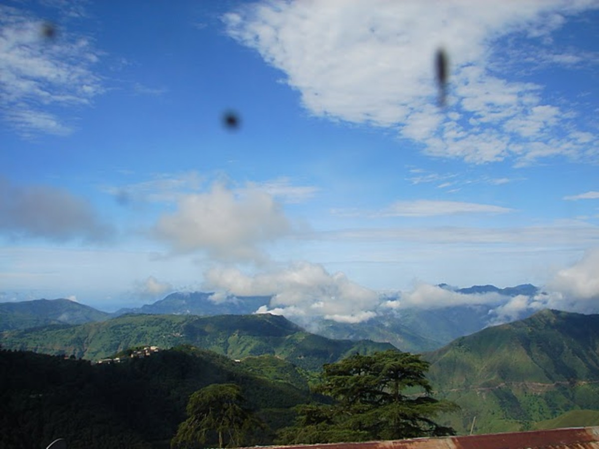 A scenic view of Chakrata via the window glass.