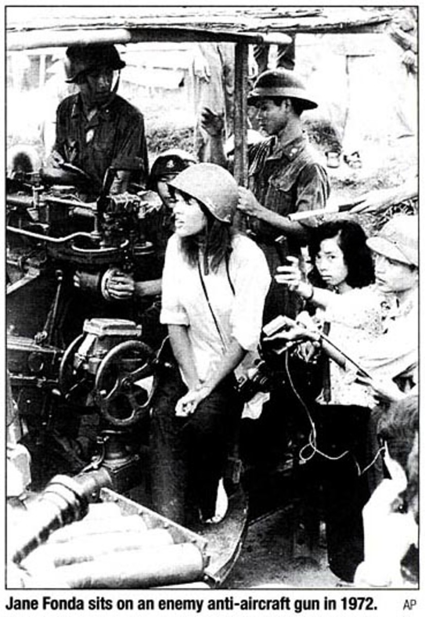 JANE FONDA PROVIDING COMMUNISTS WITH PROPAGANDA PHOTO SITTING ON COMMUNIST ANTI-AIRCRAFT GUN USED TO KILL AMERICAN PILOTS