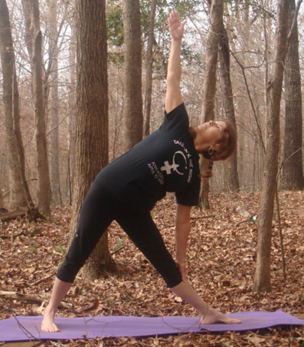 Yoga student in trikonasana, triangle pose