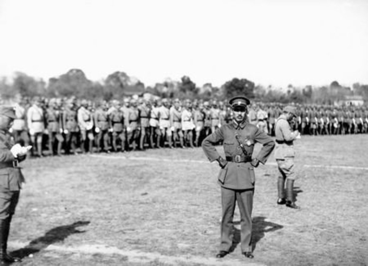 Photo taken in 1933. Chiang Kai-shek in a military parade honoring him for suppressing the People's Revolutionary Government of the Republic of China in Fujian. History discussed in Eyes of Emerald.