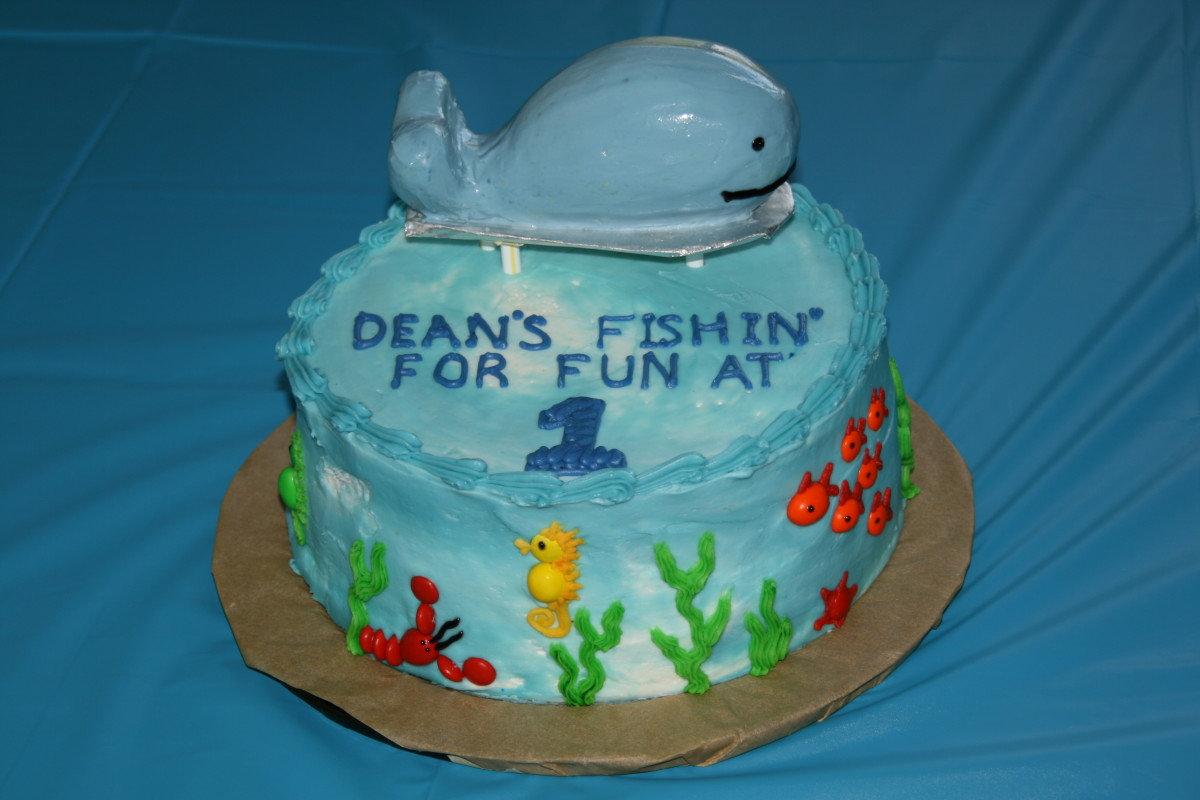 The sea creatures bodies are M&M's (a design I found online). The whale is carved out of pound cake.  This is a plain Costco cake that I decorated.