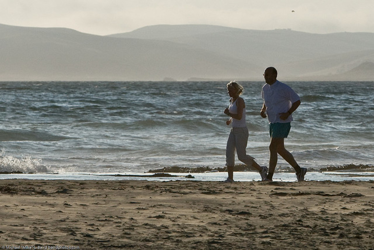 Father-Daughter Joggers at Morro Bay, California by Mike Baird