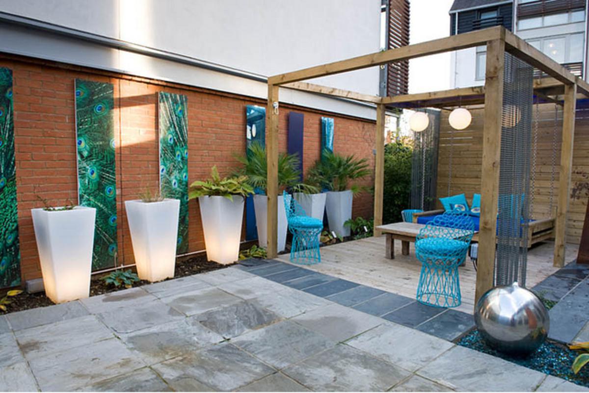 Concrete patio paving with a band of blue coloured concrete.