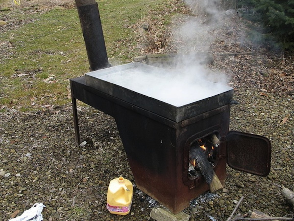 This is a typical outdoor evaporator pan heated with wood for making syrup.