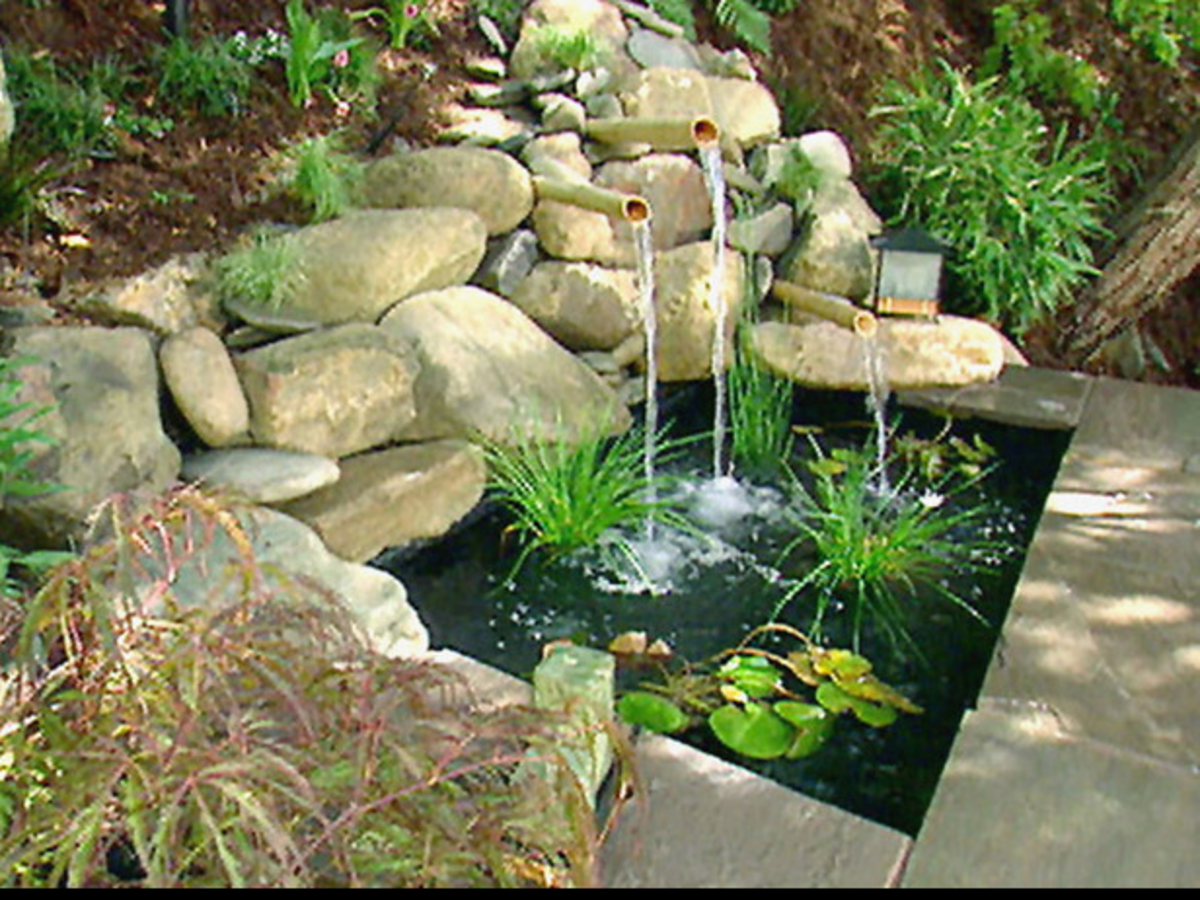 Natural setting - Patio water feature with a fountain emptying into a small pond
