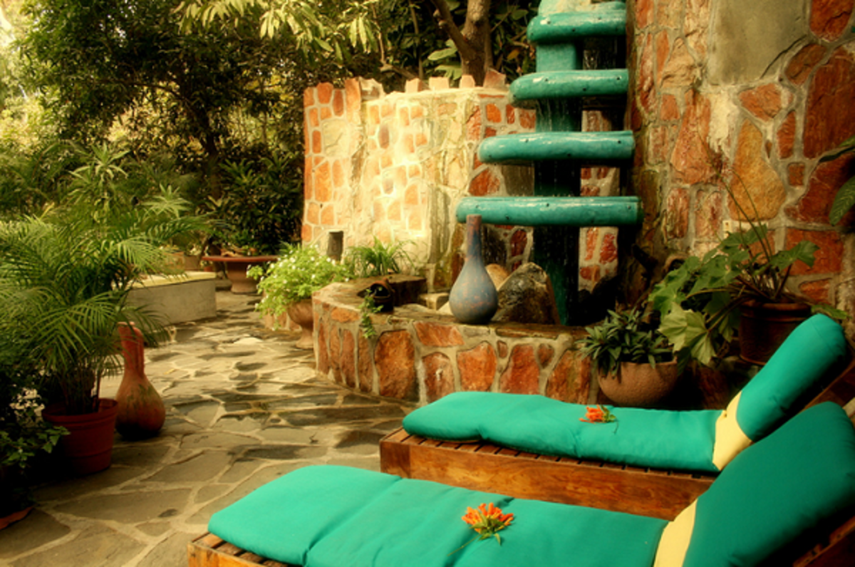 A vertical patio fountain for outdoor rooms with restricted space.