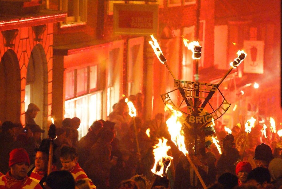 On Bonfire Night, revelers celebrate in the streets, watch fireworks, light bonfires, and burn effigies of Guy Fawkes.
