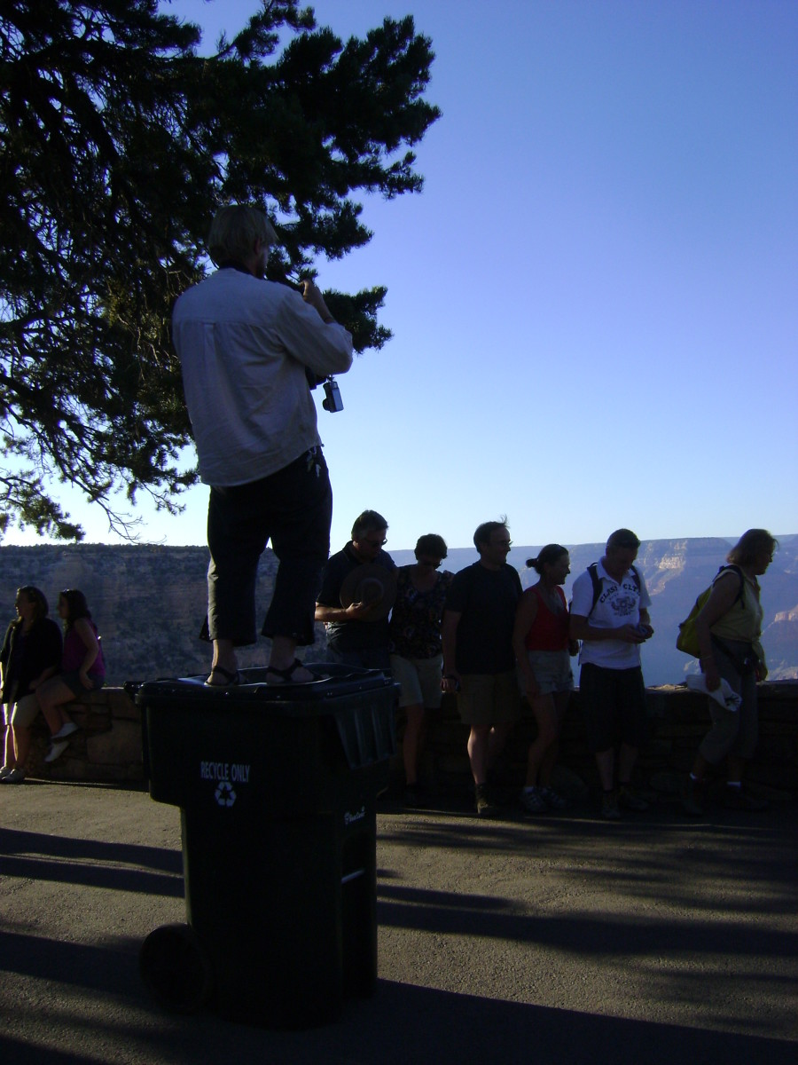 Tourist on a Trash Can