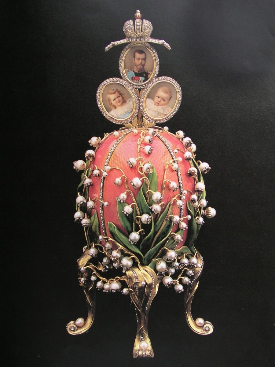 Emperor Nicholas II also presented this Lilies of the Valley egg to his wife in a style she loved with the flower that was her favorite.  The 'surprise' inside was a trio of family photographs.