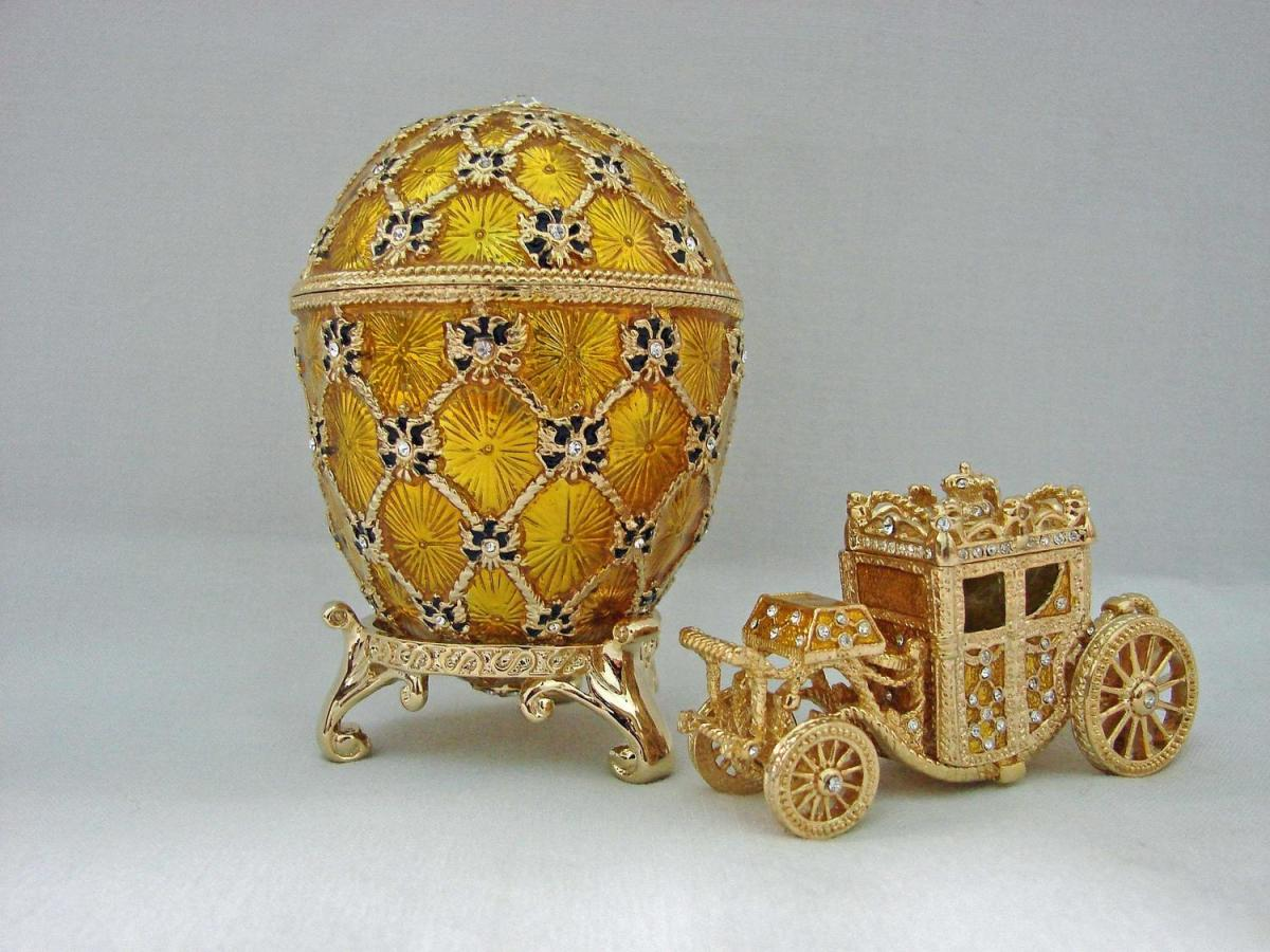 Imperial Coronation (1897).  by Emperor Nicholas II presented  this egg to his wife,  Empress Alexandra Feodorovna, as a memento of her arrival in Moscow on the day of their Coronation.