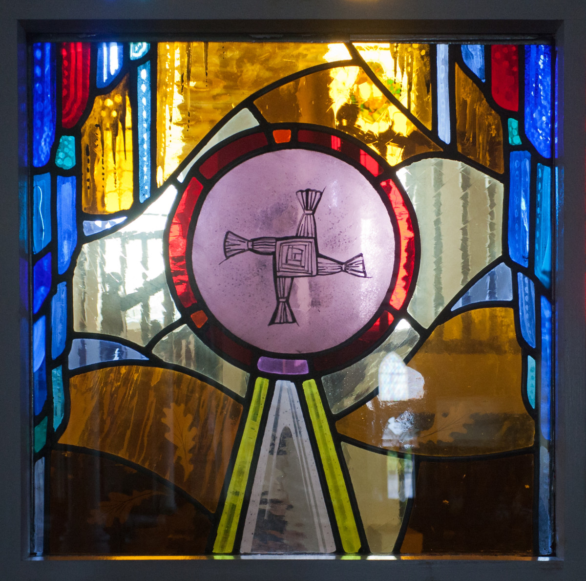 This stained glass, by Andreas F. Borchert, depicts St. Brigid's Cross.