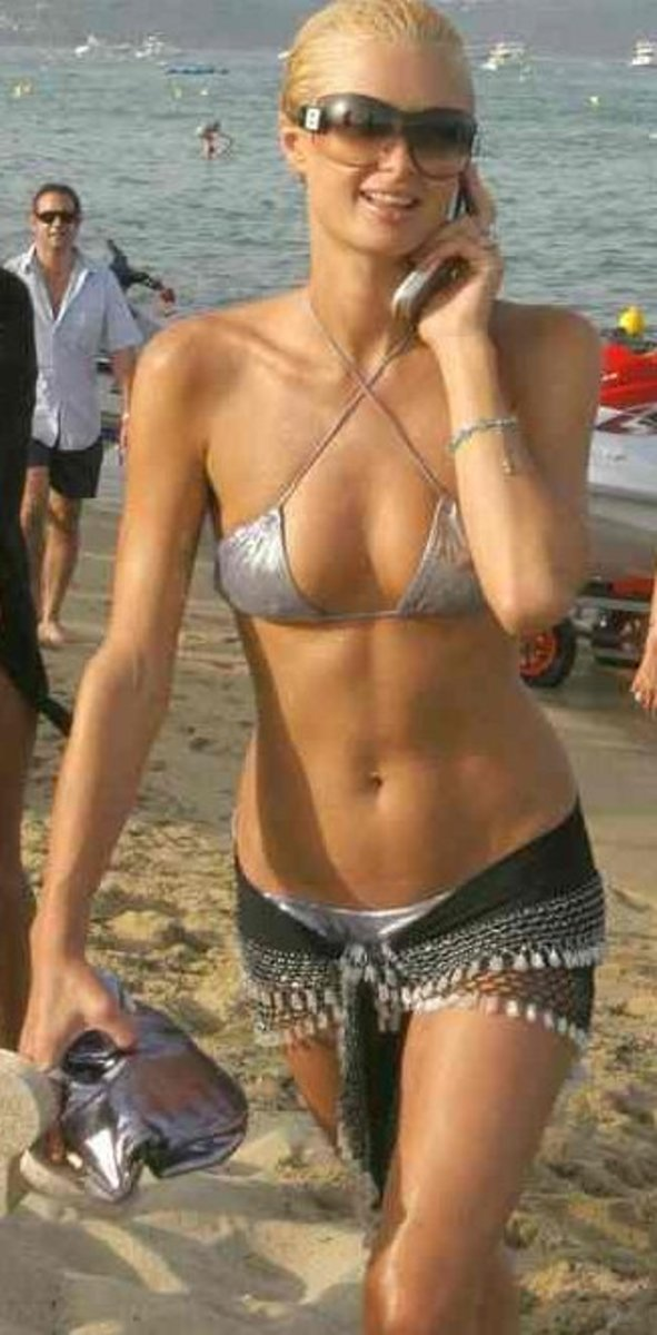 Looking like a model straight out of a calender shoot, Paris Hilton looks stunning in this silver bikini