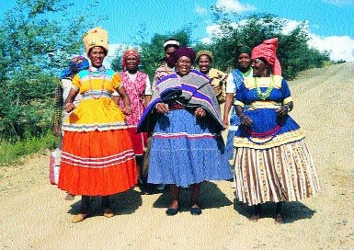 Basotho women dressed in their Sotho cultural dresses, along with embroidery on their dresses and beads in their hands and necks