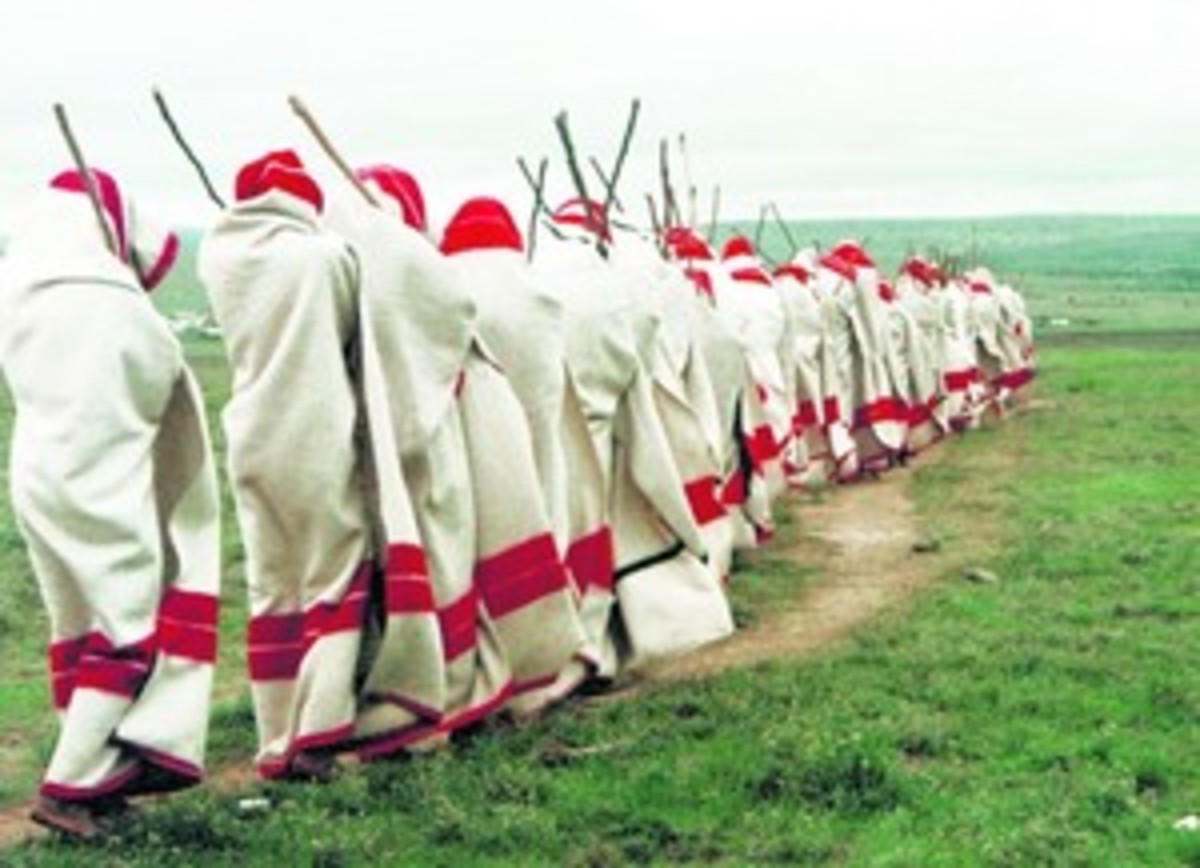 Xhosa men being initiated into manhood clad in their cultural blankets