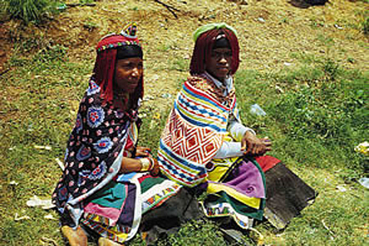 The Shangaan Women clad in their traditional wear, hair-do and colorful clothing