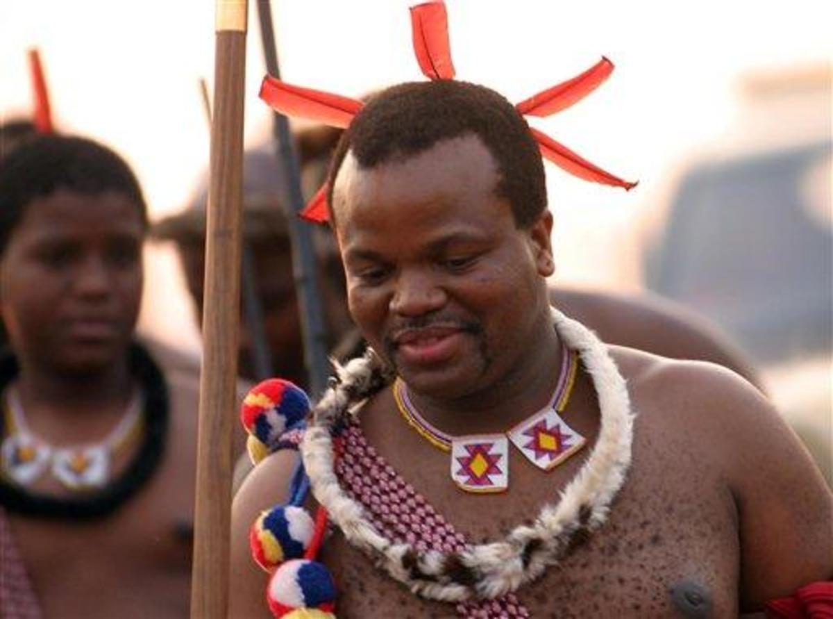"""Swazi people can be seen often clad in their traditional cloths """"aMahiya"""", colorful beads and head decoration"""