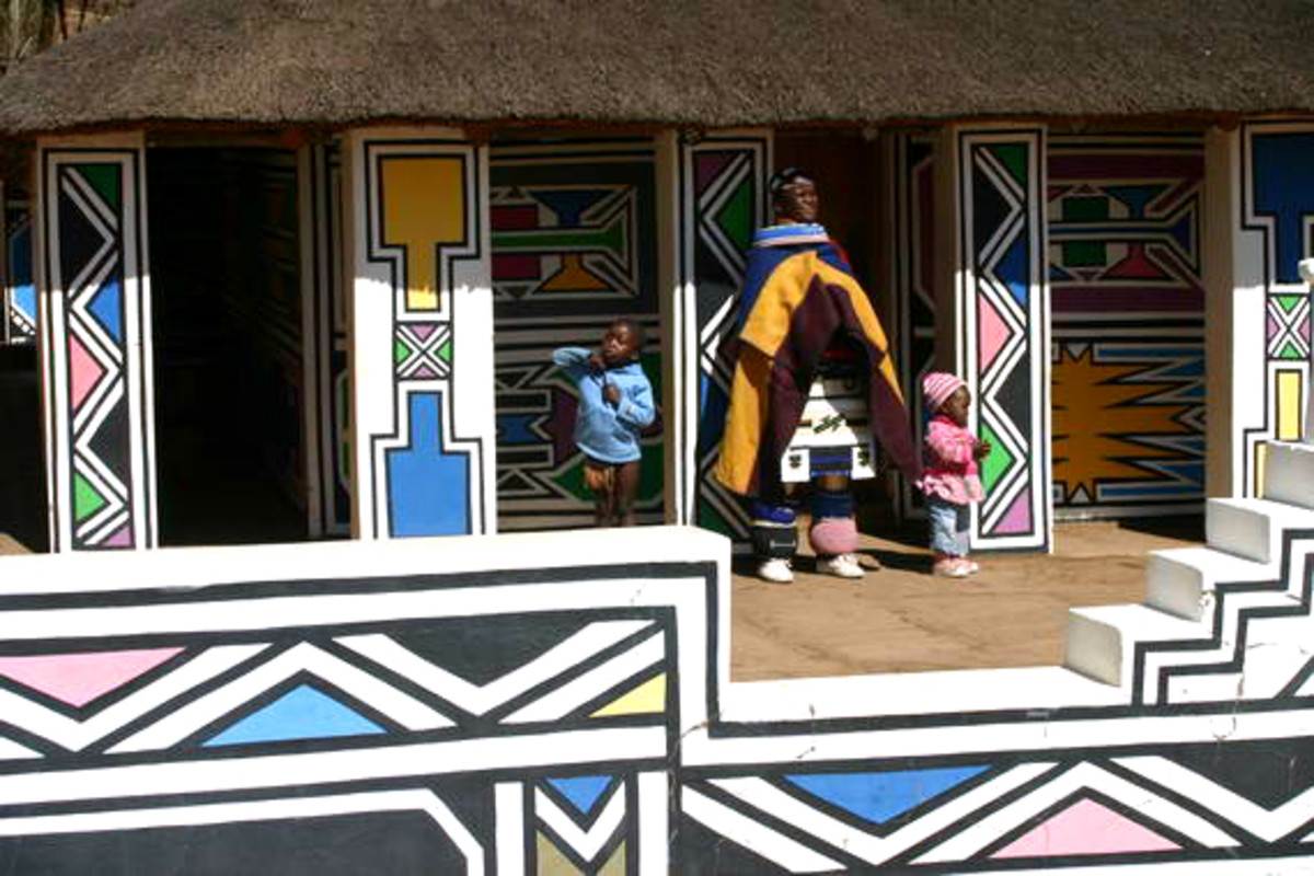 Among the Nuni/Bakone people, the Ndebeles distinguish themselves from other by specializing in their attire and with sparkling colors used in their geometric art design on  the home walls