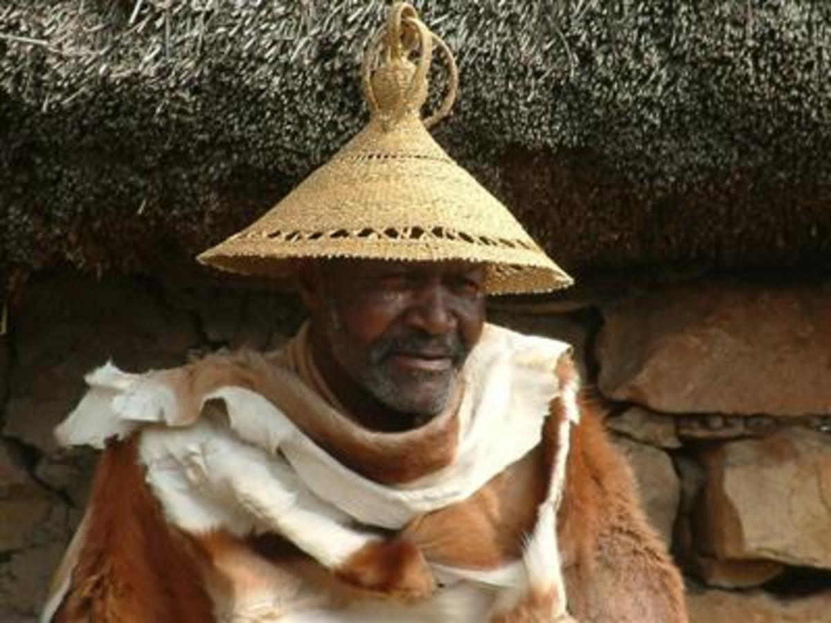 A Mosotho man wearing his hat(Modianyewo), and also wearing a goat or cow skin(most times they wear a blanket because Lesotho on the top of the mountains is a cold place