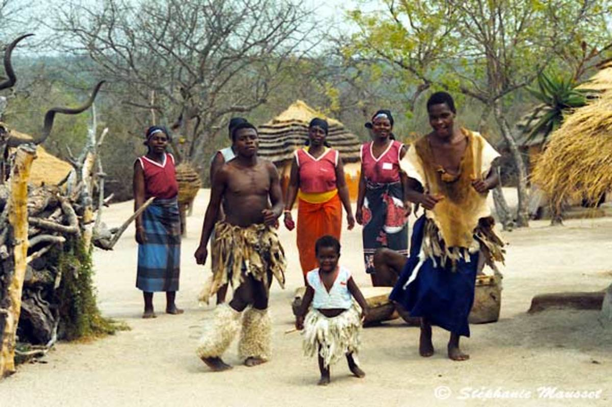 Shangaan People in a village life setting wearing their traditional clothing