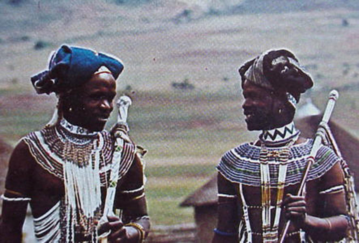 Thembu men in their traditional beaded work apparel, and decor