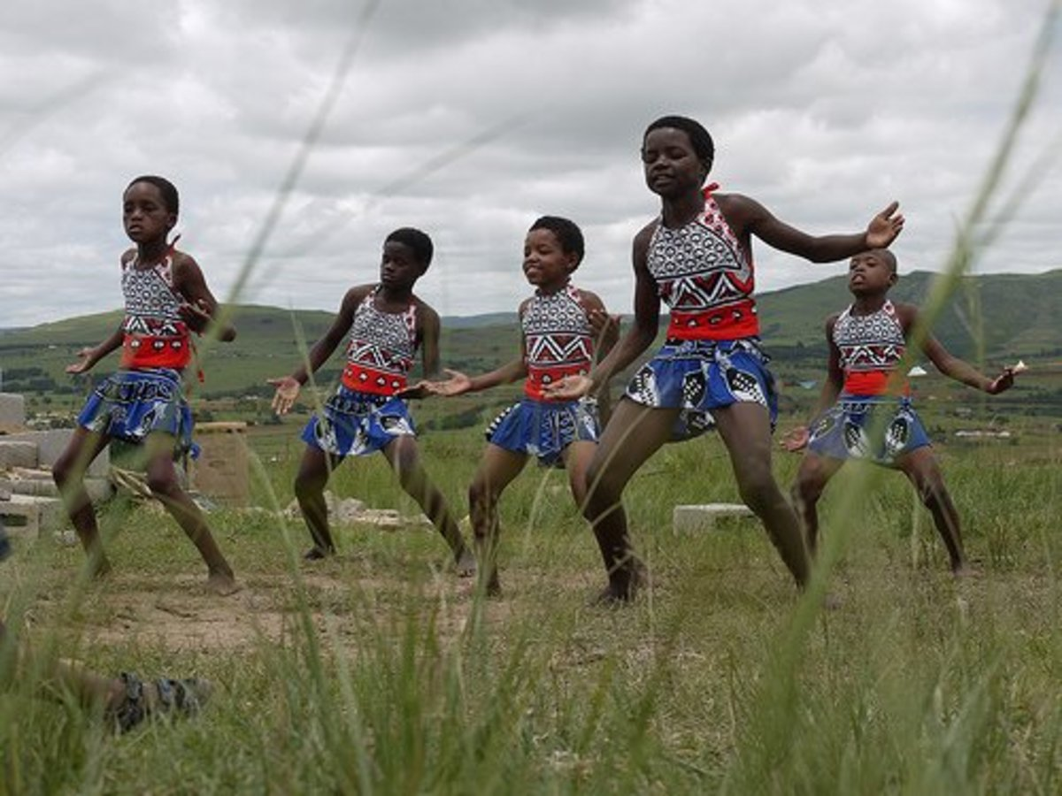 Swazi kids entertaining tourists clad in traditional garb and performing traditional and customary dances