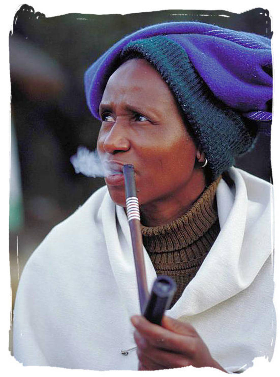 Xhosa Woman enjoying her pipe at a cultural Village