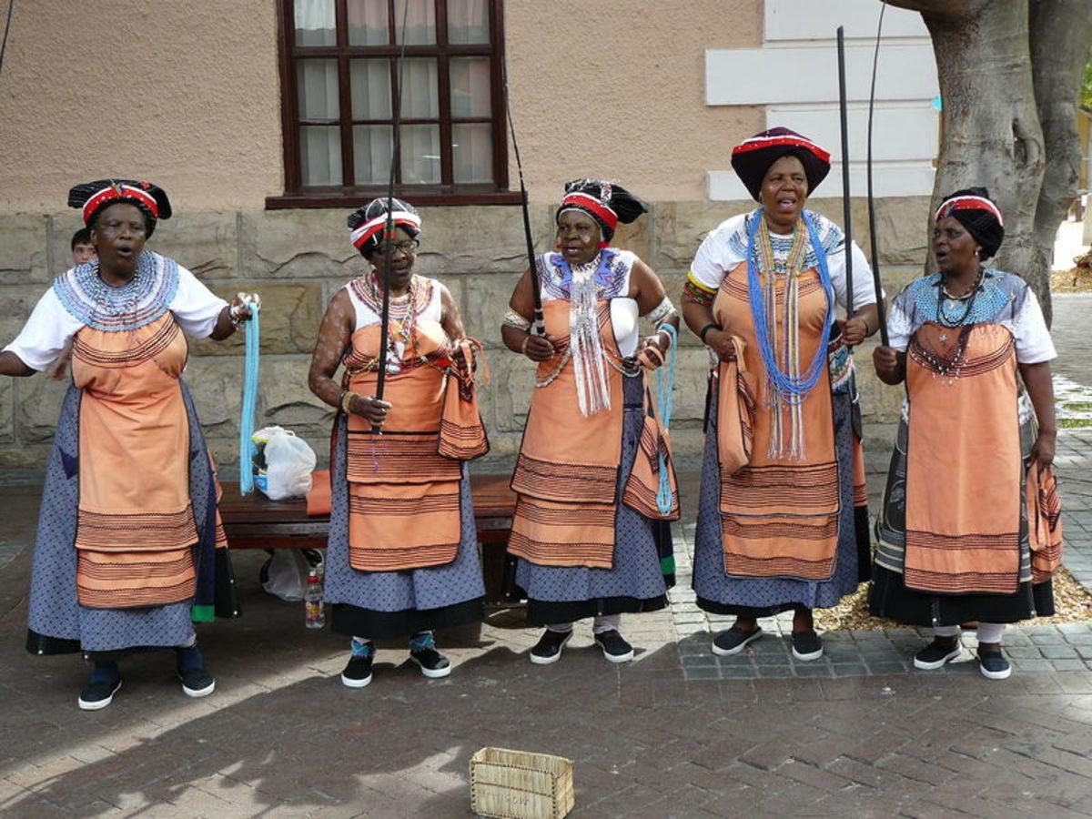 Elderly Xhosa women in Xhosa traditional wear singing Xhosa customary songs