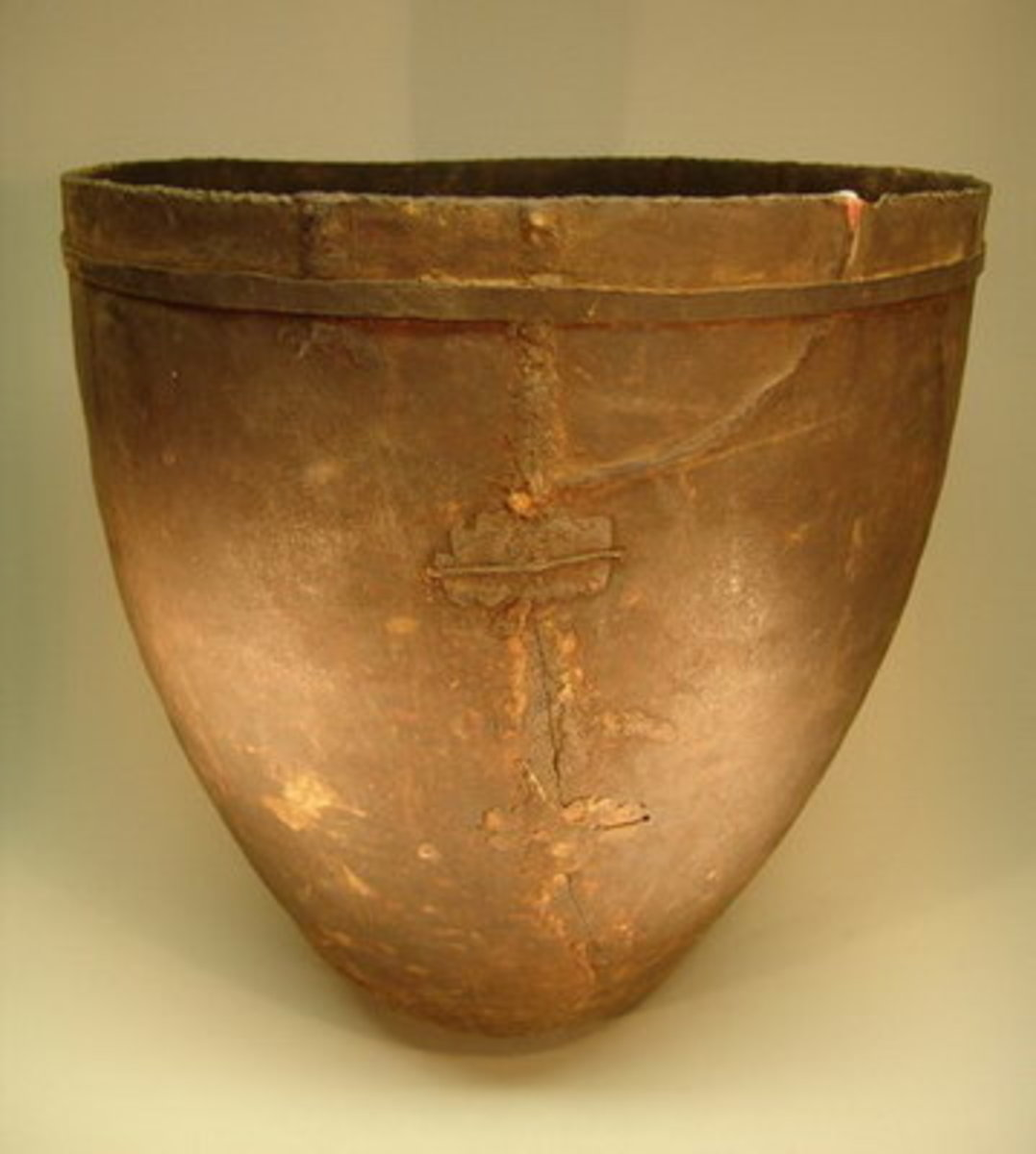 """Basotho Brewery Vessel(""""Eqho""""). This particular example was copper pegged  at two points, then sealed with hornets wax. An iron band was cut and attached to its neck for added strength"""