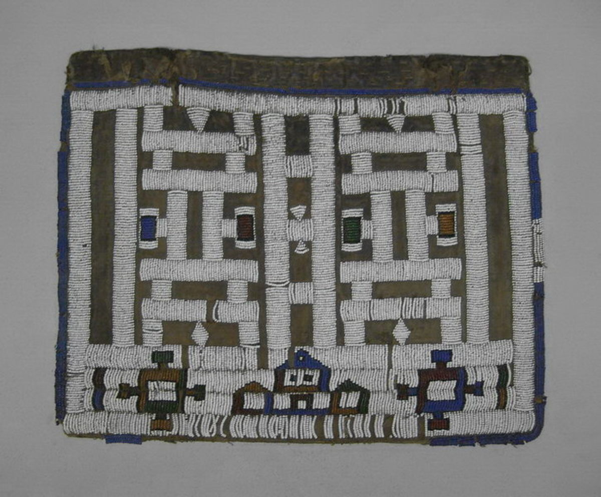 "Ndebele Apron called ""Pepetu"", which a small beaded apron worn by a young ndebele maiden after completing a period of seclusion. These ries represent female initiation"