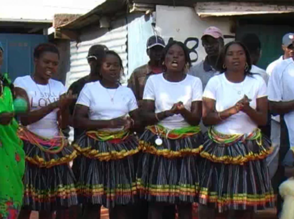 "Shangaan girls wearing their ""metjekas"" clapping hands and singing their Shangaan traditional songs"
