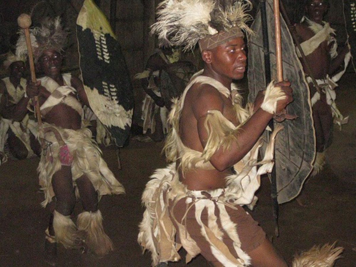 Shangaan men in a dancing and festive mode