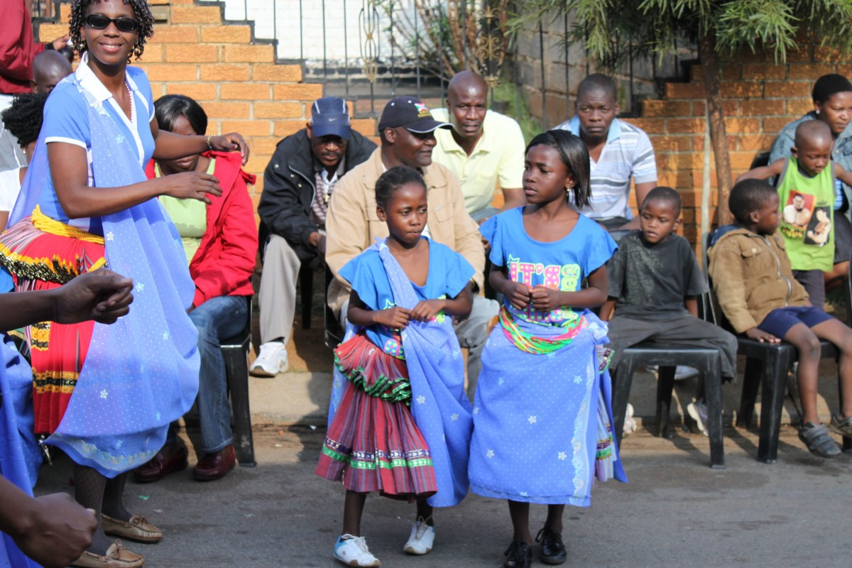 Shangaan children with their parents wearing their traditional clothing