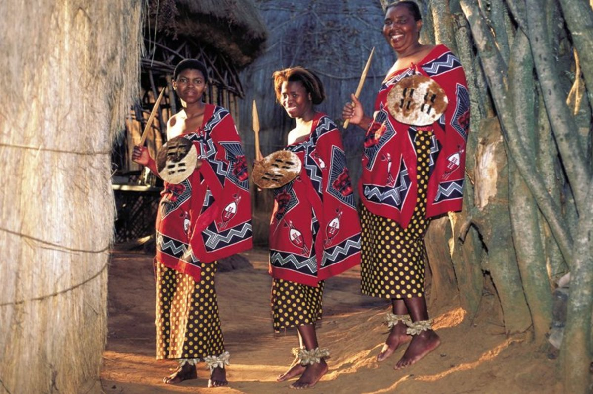 Swazi people posing for a photo wearing their traditional gabardine