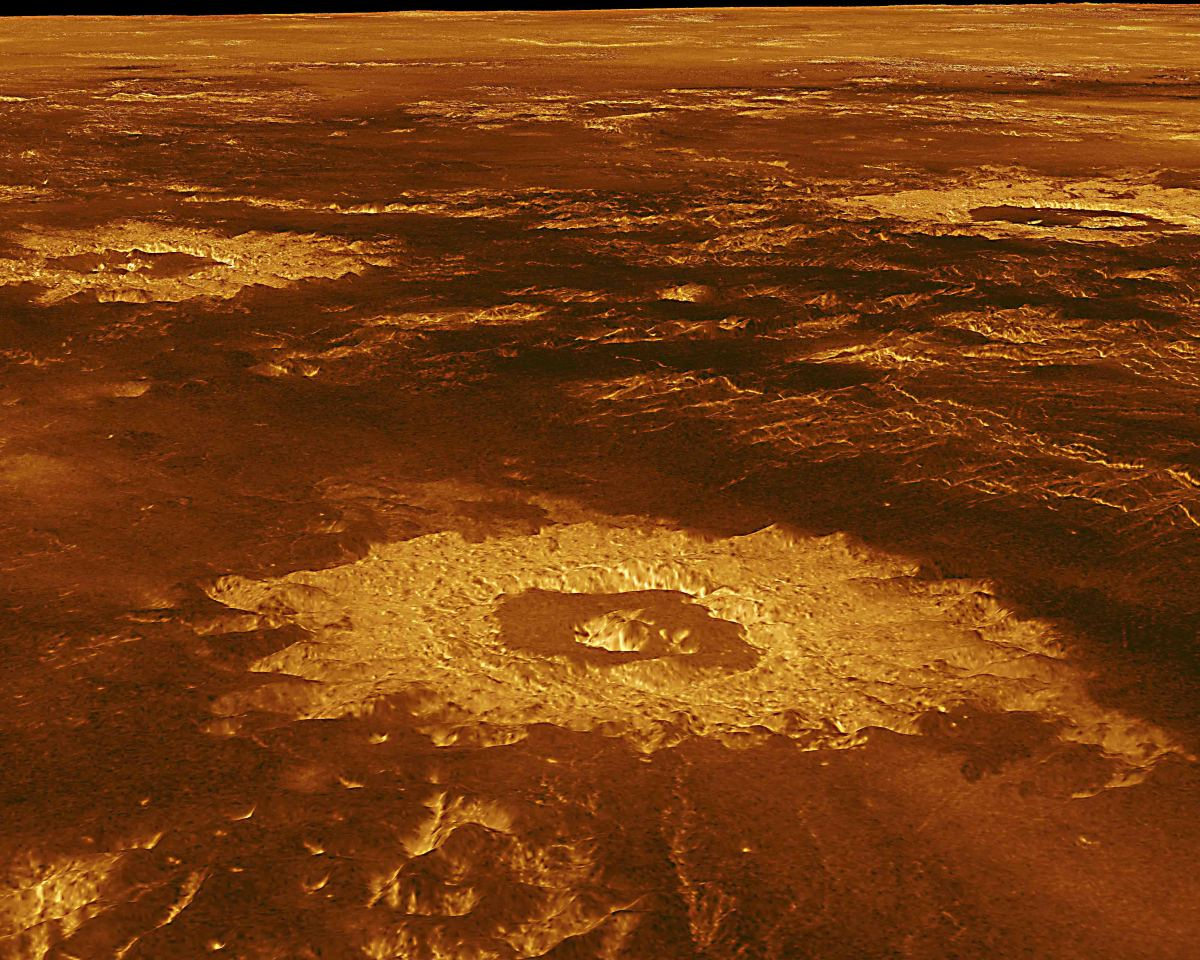 Lavinia Planitia - one of the great plains of Venus - covers a 2000 km diameter region in the southern hemisphere. In the foreground is Howe Crater 37 km (23 miles) in diameter. Also in view are the craters  Danilova (left) and Aglaonice (right)