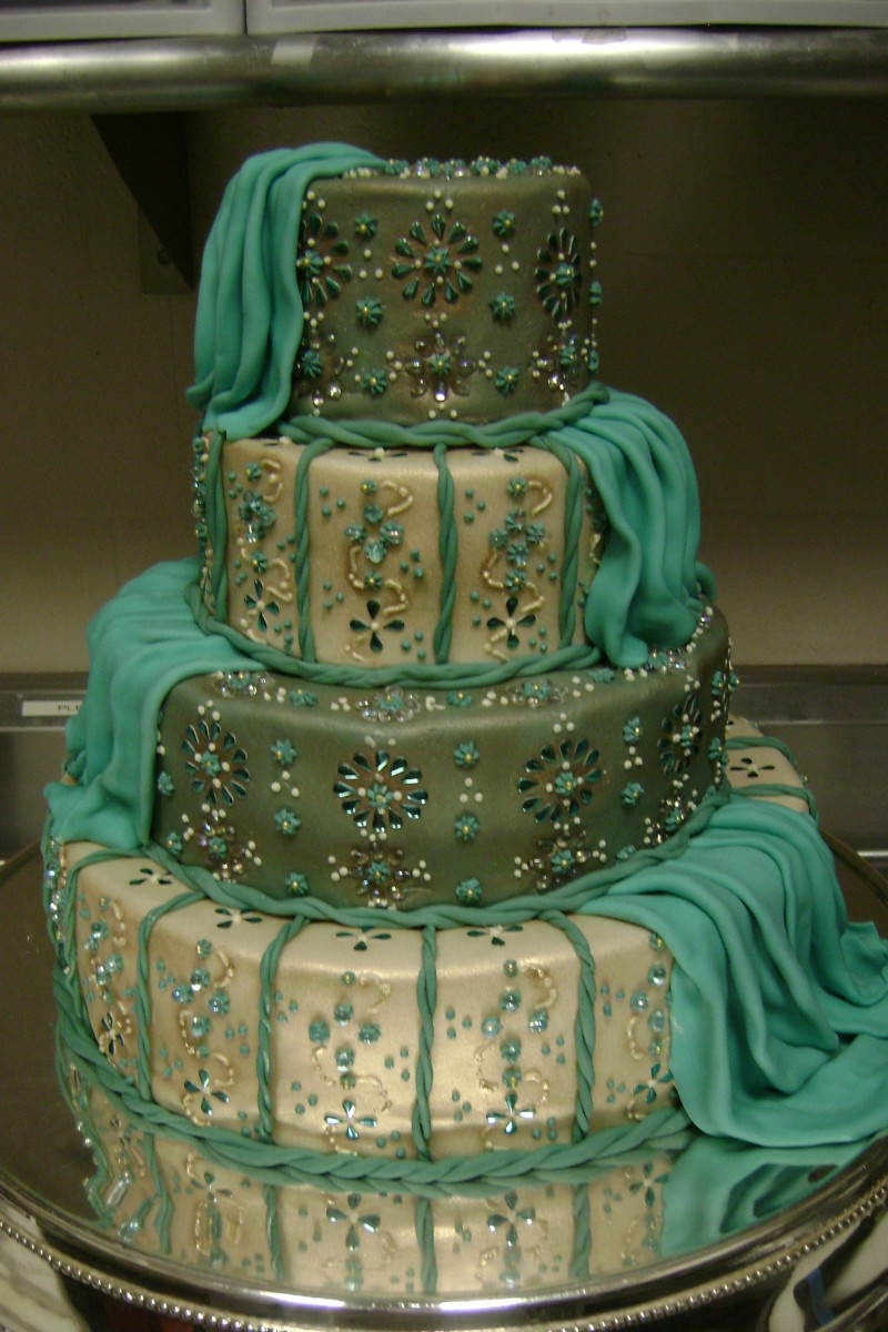 A lovely Indian Wedding Cake with a unique design. Click on the source link for more details.